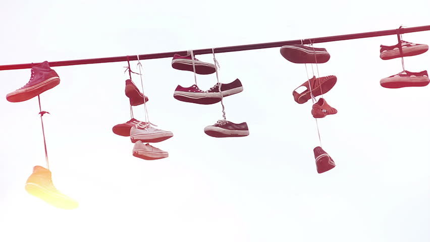 Hanging Pictures On Wire pairs of shoes hang tossed telephone wire, sneakers power lines