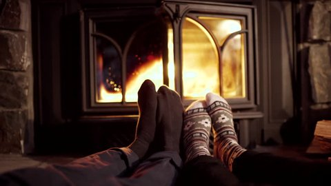 Closeup Of Couple's Feet, Warming Up By Cozy Fire