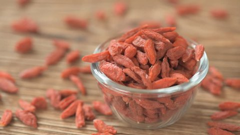 Goji berries on wooden background.