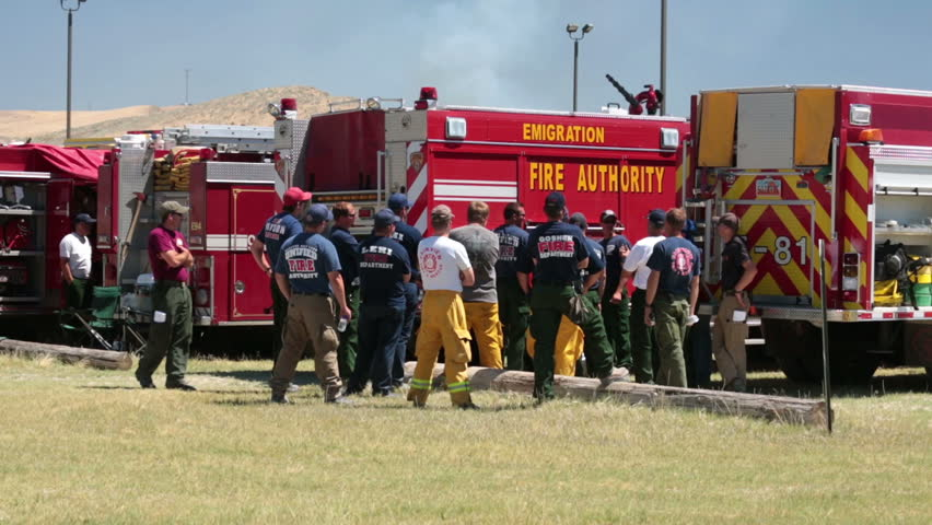 MORONI, SANPETE, UTAH 25 JUN 2012: Firemen with fire trucks and equipment prepare at briefing to fight dangerous out of control wildfire. Wood Hollow Utah. FEMA Federal Government assistance.