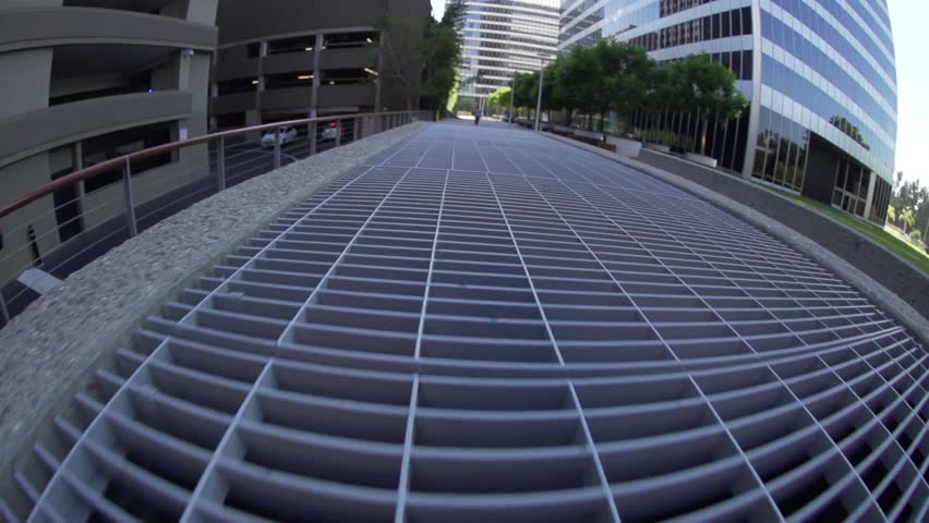 Smooth, wide-angled, tracking shot hovering over a metal grate. Shot at 240fps. | Shutterstock HD Video #24608648