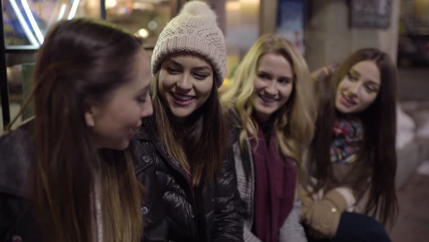 Fun Group Of Friends Wait For Food Outside Of Restaurant, They Chat On Bench And Laugh | Shutterstock HD Video #24609044