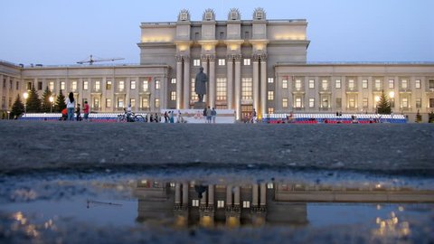 People walk on Square of Kuibyshev in Samara in Victory Day in evening, time lapse