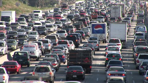 Los Angeles, CA - CIRCA February 2006: Heavy traffic on Freeway results in 93 hours of delays per person every year.