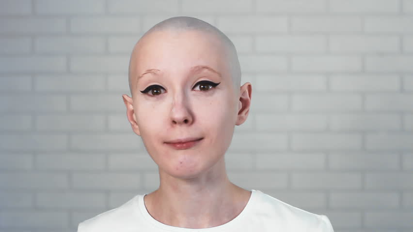 Portrait of a sad, depressed woman suffering from cancer looking into the camera | Shutterstock HD Video #24695618