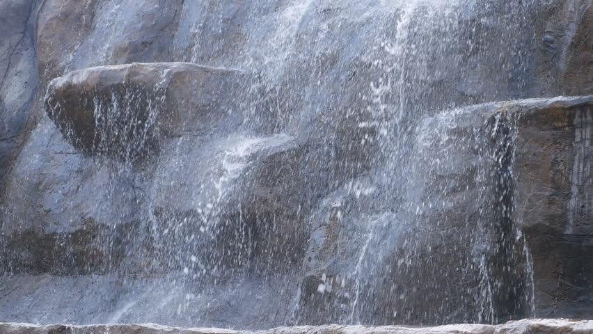 4k Close up of Beautiful waterfall in garden. Waterfall in garden