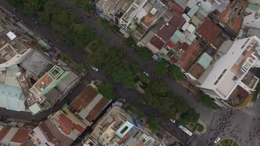 Aerial top view of crowded street with motorbikes in chinatown of Saigon Ho Chi Minh City Vietnam