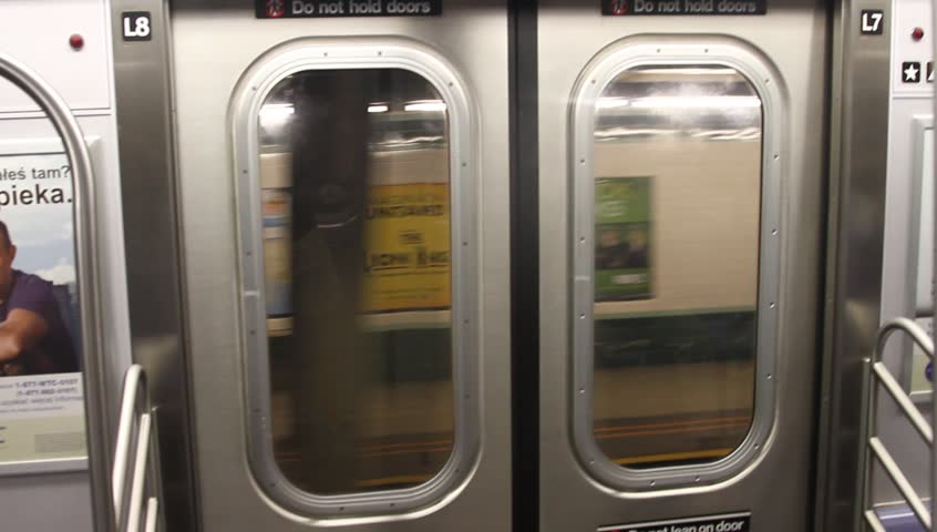 ... 2011 - New York Metro station the train moves from station An interior view of the doors on a New York City subway car as they open at the platform. & Stock video of an interior shot of closed new | 22512280 | Shutterstock