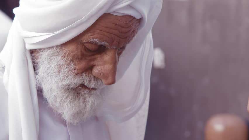 Manama, CIRCA September 2016: Old Arab Jewelery Seller Examining A Ring Bahrain