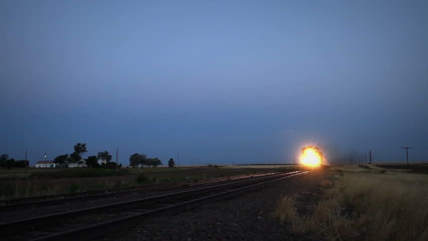 Very fast moving train at dawn in rural Colorado. HD 1080p.