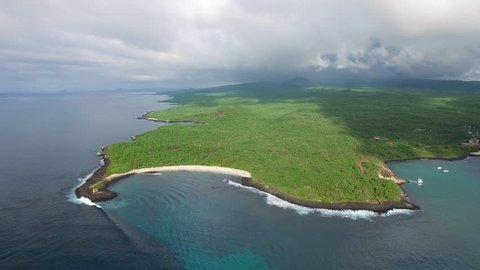 Aerial view of lush jungle landscape of San Cristobal island coast, tropical paradise of Puerto Baquerizo Moreno, Galapagos capital, Ecuador