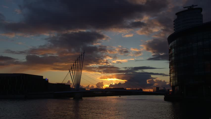 Salford, England. April 2016. Sunset  timelapse over the MediaCity UK Complex at Salford Quays. MediaCityUK is s mixed-use property development with an emphasis on broadcasting and digital creativity.
