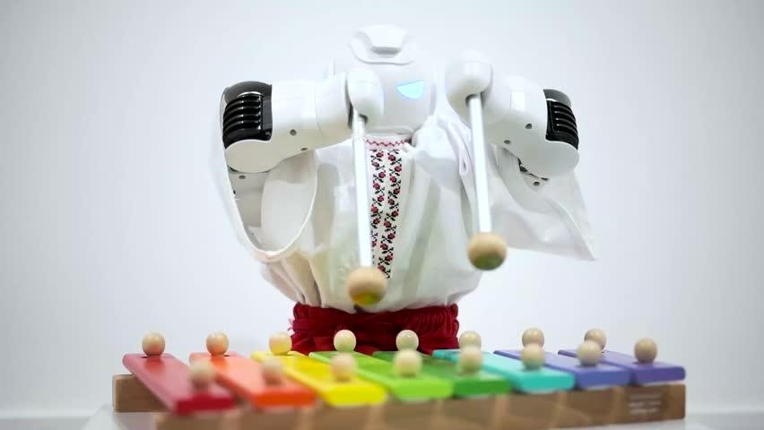 Robot plays a musical instrument.