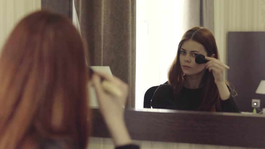 Woman applying makeup | Shutterstock HD Video #24831518