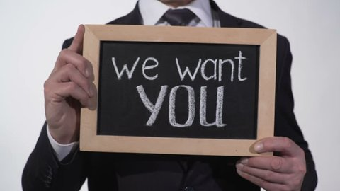 We want you phrase on blackboard in businessman hands, promising job offer