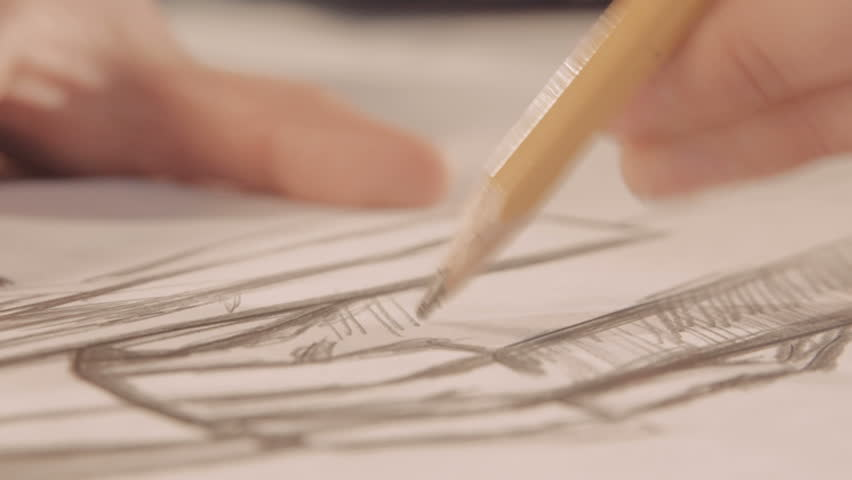 Girl draws a pencil on paper. Female fashion designer drawing sketches. Fashion designer drawing and paint. Close-up