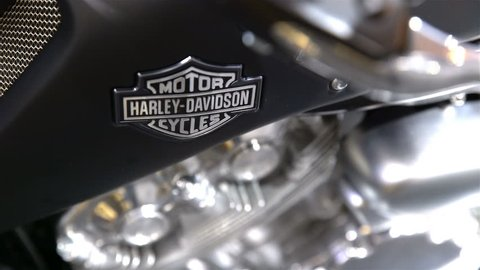 HELSINKI, FINLAND - FEB 03, 2017: The newest legendary Harley Davidson motorcycle. The label on the tank. Motorcycles, mopeds, scooters, riding gear, spare parts and many people at the largest