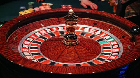 The small ball falls into the slot as the Roulette Wheel spins.