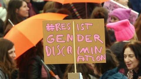 Amsterdam, March 11, 2017. Sign 'Resist Gender Discrimination' at Women's March Amsterdam