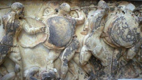 Ancient Greece war scene representation in stone relief frieze