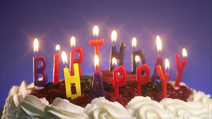 Candles On A Birthday Cake Being Blown Out