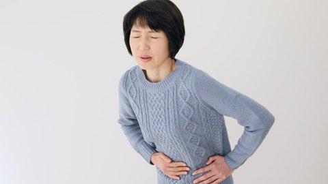Asian woman having a stomachache