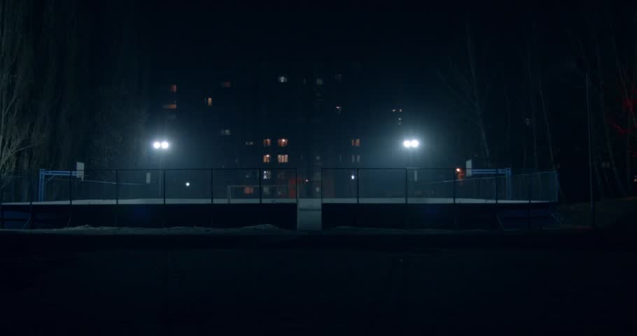 Scene: street sports at night. The stadium is lit by floodlights. Color contrast. Buildings on the background. Opening frame. Tilt and orange. Low angle.   Shutterstock HD Video #25162478