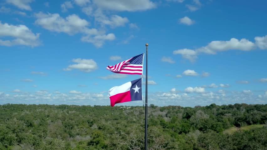 American Flag Flying Over the Texas Flag