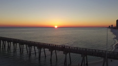Sunset over the Gulf of Mexico, Drone flying over pier.