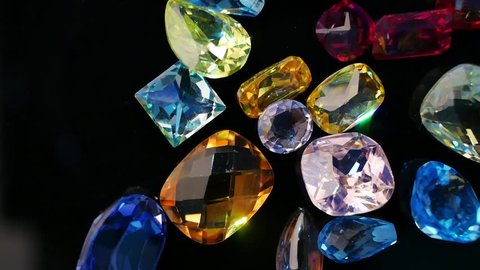 Jewel or gems on black shine table, Collection of many different natural gemstones amethyst, lapis lazuli, rose quartz, citrine, ruby, amazonite, moonstone, labradorite, chalcedony, blue topaz