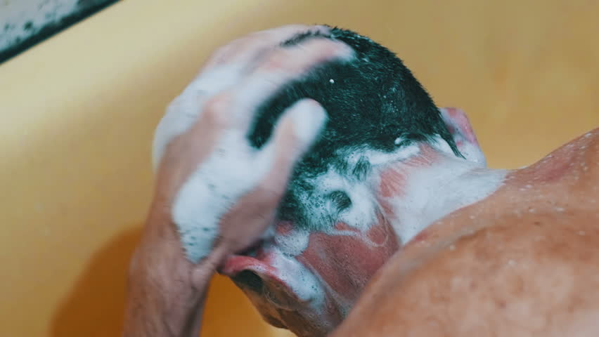 Young Man Washes His Head Under The Shower. Take A Shower With ...