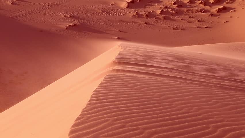 Red sand close up Sahara desert. Sunset. Sand dunes and blue sky. Beautiful desert landscape. Sahara desert. Sand dunes Arabian desert. Sand dunes wave pattern. Nature background. With sound. | Shutterstock HD Video #25217828