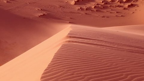 Red sand close up Sahara desert. Sunset. Sand dunes and blue sky. Beautiful desert landscape. Sahara desert. Sand dunes Arabian desert. Sand dunes wave pattern. Nature background. With sound.