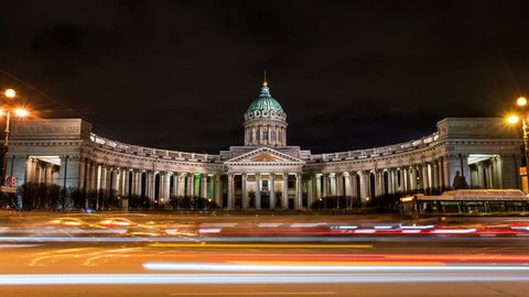 St Petersburg, Russia. Illuminated Cathedral of Our Lady of Kazan, Russian Orthodox Church in Saint Petersburg, Russia at night with car traffic trail lights at the forefront. Time-lapse