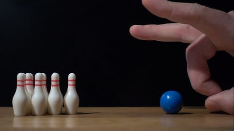 Super slow motion footage with falling skittles with bowling ball.