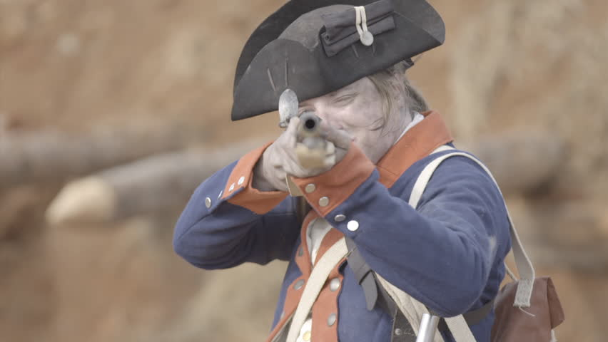 VIRGINIA - OCTOBER 2016 - American Revolution era Continental Patriot Soldier. Re-enactors, reenactment.  Firing Brown Bess musket gun with black powder and lead bullets in earthen fort in battle.  | Shutterstock HD Video #25273763