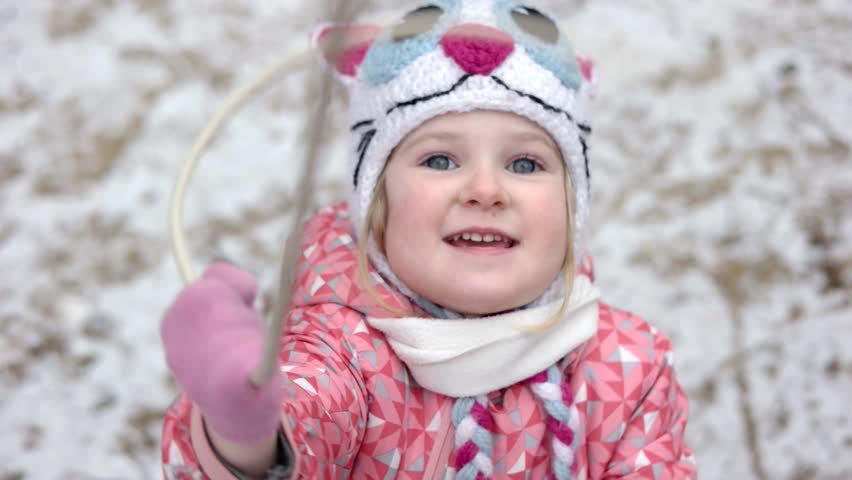 Cute Little Blonde Girl Playing Outdoor on the Snow. Close-Up Portrait of 3 Year Old Funny Girl | Shutterstock HD Video #25309028