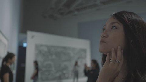 woman visiting art gallery