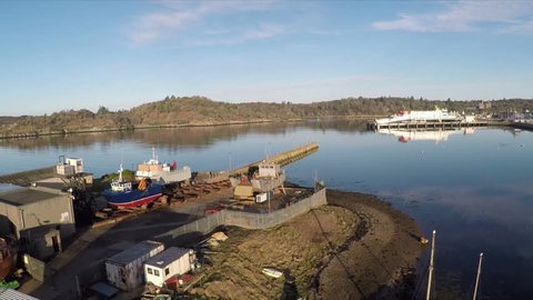 2.7k Aerial footage of Stornoway harbour and Goat Island Dry-dock and slipway Isle of Lewis Western Isles Outer Hebrides Scotland United Kingdom.