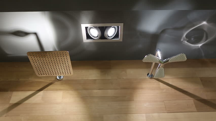 Triangle Rain Showerhead And Square Showerhead With Open Running Water  Closeup In Luxury Bathroom. Modern