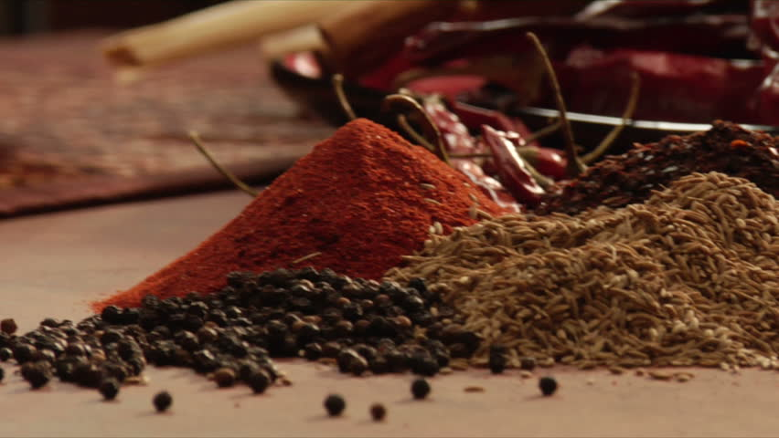 pan over mexican spices to reveal chili powder from a mocaljete