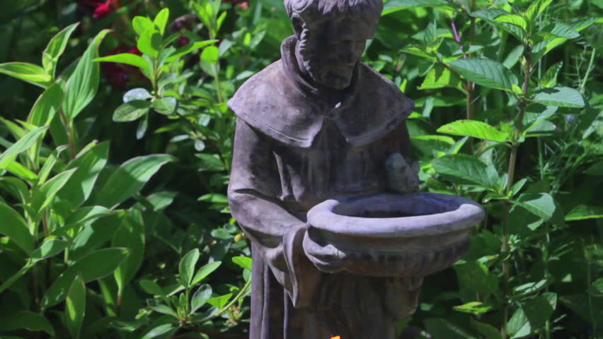 Pan Over Garden Flowers And St Francis Statue