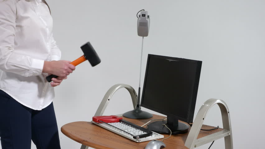 Stressed office worker smashing desktop computer with sledgehammer trying to reduce stress | Shutterstock HD Video #25420358