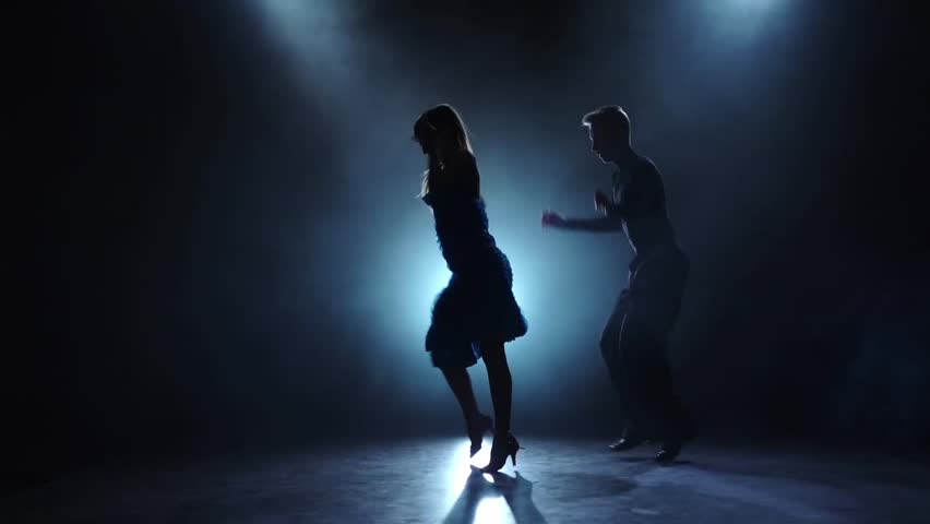 Dance cha-cha-cha performed by a professional couple in slow motion
