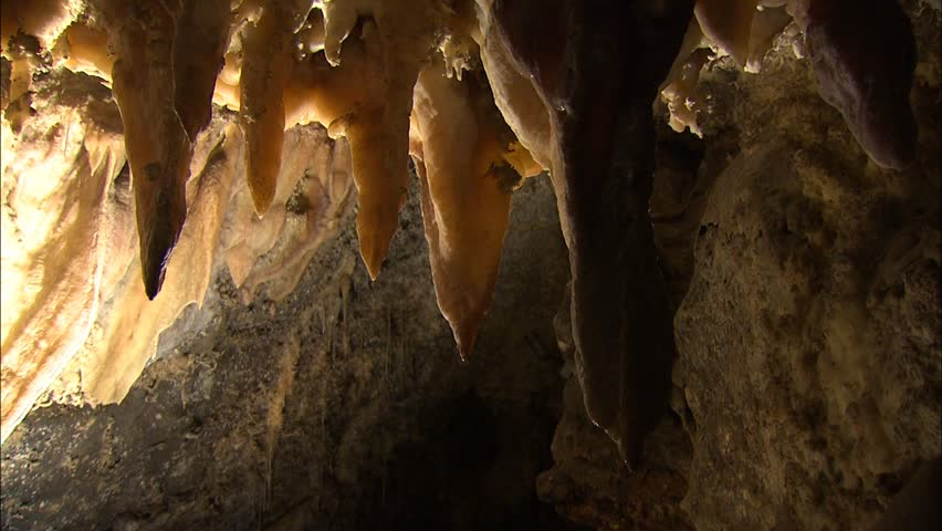 Row of stalactites with dramatic lighting