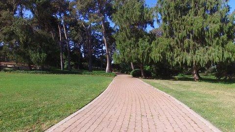Aerial footage - Park trail at the vast gardens of Baron Edmond James de Rothschild at Ramat Hanadiv