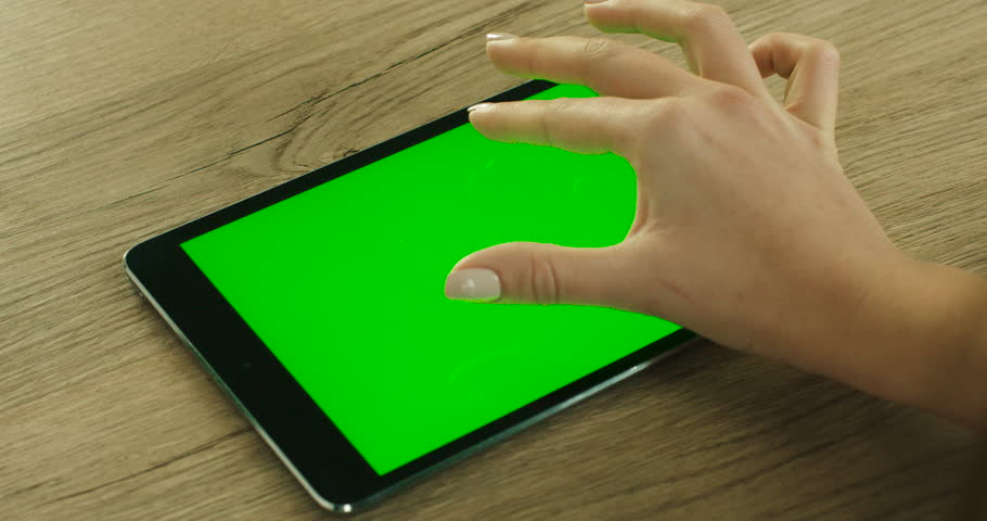 Woman hands using tablet with green screen. Fingers scrolling pages, news on green touchscreen. Close up. Chroma key | Shutterstock HD Video #25521758