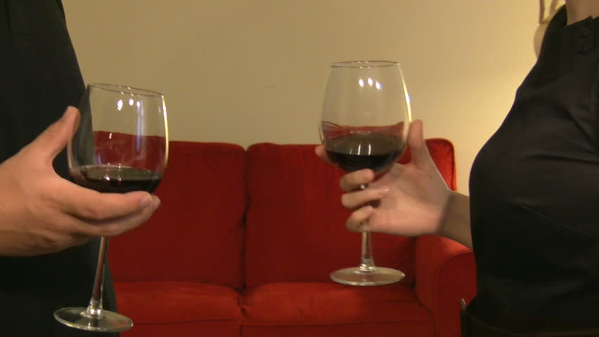 making a toast with a glass of vine by young couple