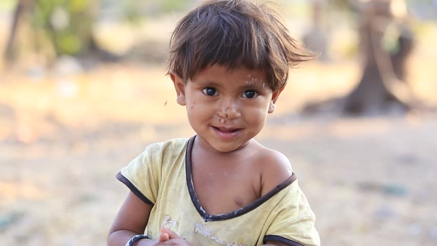 MANDU, INDIA - FEBRUARY 03, 2017 : An unidentified Indian child on the street . Poverty is a major issue in India