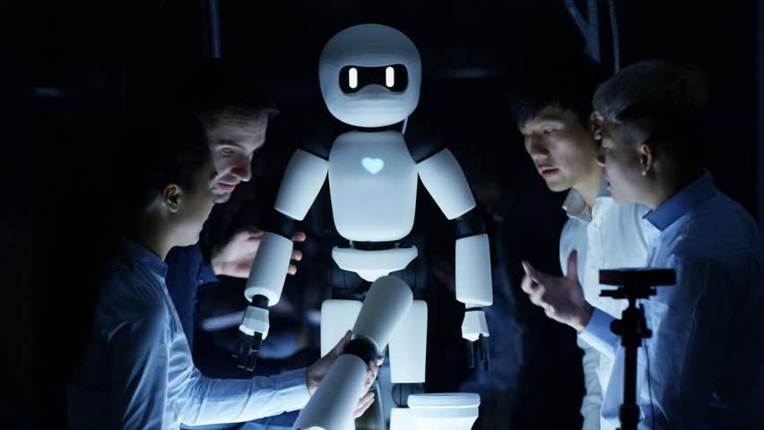 4K Electronics engineers collaborating on design of robot in dark lab | Shutterstock HD Video #25573865